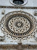 Rosette Above The Entrance To The Basilica Of St. Francis In Assisi,