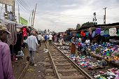 KIBERA, KENYA-DECEMBER 8 2010: Merchants sell their wares along the railroad tracks in Kibera, Nairobi, Kenya's largest slum