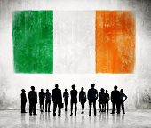 Silhouettes of Business People and a Flag of Ireland