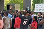 FERGUSON, MO/USA -  AUGUST 15, 2014: Crowd reacts at the Site of Quick Trip after Police Chief Thomas Jackson release of the name of the officer that shot Michael Brown.
