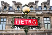 Red art deco Metro sign and lamp post