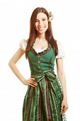 Smiling happy bavarian woman in green dirndl dress