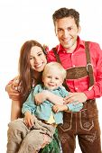 Happy family in bavaria smiling with child