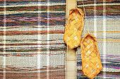 image of baste  - Russian bast shoes on a background mat - JPG