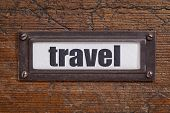 travel  - file cabinet label, bronze holder against grunge and scratched wood