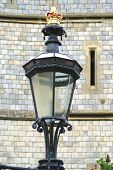 Electric lamp decorated with a crown