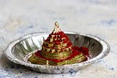 Vermillion sprinkled on Mahameru also called Sri Yantra a Hindu religious spiritual tool