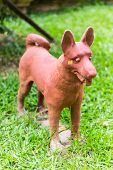 Thai Dog Statue On Grass