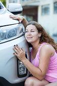 Young Caucasian Woman Adoring Her New Car