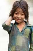 MUKTINAH, NEPAL, NOVEMBER 12 : little unidentified Nepalese girl posing on the road near Muktinah vi