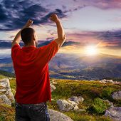Man Among Stones At Mountain Top