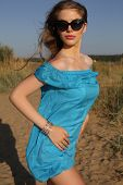 Beautiful Girl In Blue Dress With Sunglasses