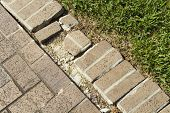 Close Up Of A Brick Walkway Edge In Need Of Repair
