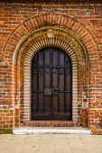 Old Door Of Medieval Cistercian Monastery In Kolbacz, Poland