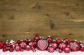 Christmas Background Of Wood Decorated With Red Balls And Snow.