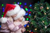 Santa Claus Kids Near Christmas Tree Over Bright Festive Background