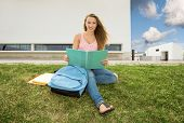 Beautiful and happy teenager studying in outdoor