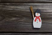 Snowman On Wooden Background For Christmas Decoration.