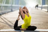 Woman Doing Stretching Yoga Exercises Outdoors