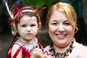 MUSKOGEE, OK - MAY 24: Unidentified mother and daughter dressed as a cute elf enjoy the Oklahoma 19th annual Renaissance Festival on May 24, 2014 at the Castle of Muskogee in Muskogee, OK