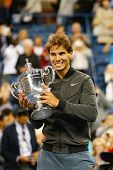 US Open 2013 champion Rafael Nadal holding US Open trophy during trophy presentation