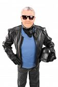 Vertical shot of a cool senior in a leather jacket isolated on white background