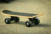 Lone Skateboard Deck On Asphalt Background