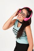 Cute Nerdy Girl Listening To Music Whilst Looking At Camera.