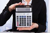 Businesswoman Showing Calculator