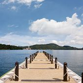 image of dock a lake  - Dock under blue sky - JPG