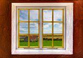 View Of A Barn And Farmland Through A Window
