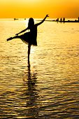 Silhouette Of A Girl In The Sea At Sunset