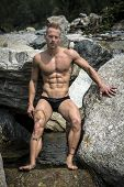 Handsome Young Muscle Man In Water Pond, Naked Against Rock