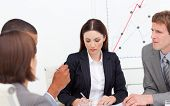 Brunette Female Executive Presenting Statistics