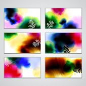 Set of visiting cards with ink blots of different colors and silhouettes of plants on white  backgro