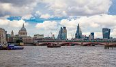 LONDON, UK - AUGUST 9, 2014  South bank walk of the river Thames. St. Paul's cathedral. View on brid