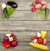 Summer frame with fresh organic vegetables on wooden background