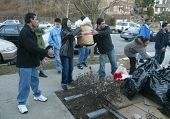NEW YORK - JANUARY 1:  Sri Lankan-Americans help pass along food and clothing outside the Buddhist V