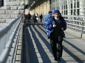 NEW YORK - DECEMBER 21:  A jogger runs over the Queensborough Bridge (59th Street Bridge) during the