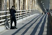 NEW YORK - DECEMBER 21:  A photographer stops to take pictures while on the Queensborough Bridge (59th Street Bridge) during the second day of the transit strike December 21, 2005 in New York City.