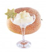 Fresh melon and pieces of melon in goblet isolated on white