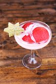 Watermelon with yogurt in goblet on wooden background