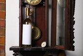 image of pendulum clock  - Bottle of white wine with blank label template standing inside an old clock - JPG