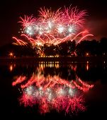 Huge Fireworks With Reflection On The Water