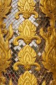 wall carving art with stained glass Wat-Grang-Suan-Dok-Mai Buddhist temple northern of Thailand.