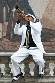 HAVANA, CUBA - JANUARY 8, 2015 : Black cuban musician playing the trumpet