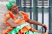 HAVANA, CUBA - JANUARY 8, 2015 : Senior black woman wearing a traditional dress in Old Havana
