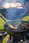 Cooking Chicken On An Outdoor Barbecue