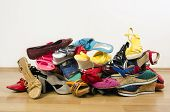 picture of untidiness  - Untidy stack of shoes thrown on the ground - JPG