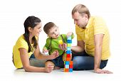 kid with his parents playing building blocks